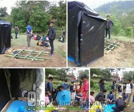 Voluntarios construyendo cuartos de baño para los afectados por el terremoto. Foto: Paula Rivas.